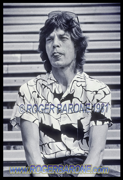 mick jagger playfully poses for photographers at JFK Stadium Stones press conference august 1981 photo by roger barone