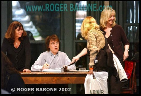"Former Rolling Stones' bass player, BIll Wyman, signs copies of ""Rolling With The Stones"" at Union Square author event. Photo © roger barone 2002"