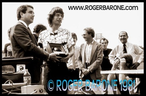 Rolling Stones Mick Jagger receives a replica Liberty Bell in Philadelphia from Dick Doran (8/26/81) © roger barone 1981