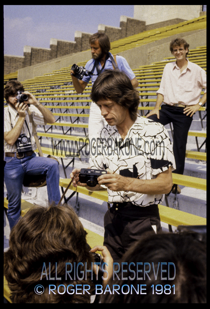 Mick Jagger with camera prepares to take a photo a JFK Stadium (8/26/1981) photo by roger barone