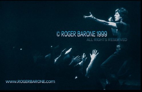 Mick Jagger sings among fans on secondary stage. First Union Center (3/15/12) © roger barone 1999