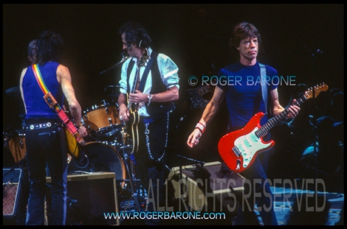 Mick Jagger plays red stratacaster at First Union with Rolling Stones (3/15/99) © Roger Barone 1999