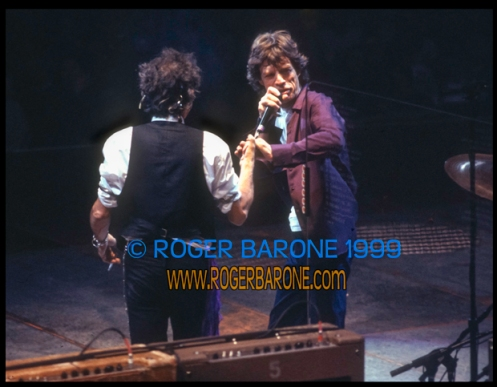 Rolling Stones Mick Jagger and Keith Richards clasp hands at Philly First Union Center concert (3-15-99) © roger barone