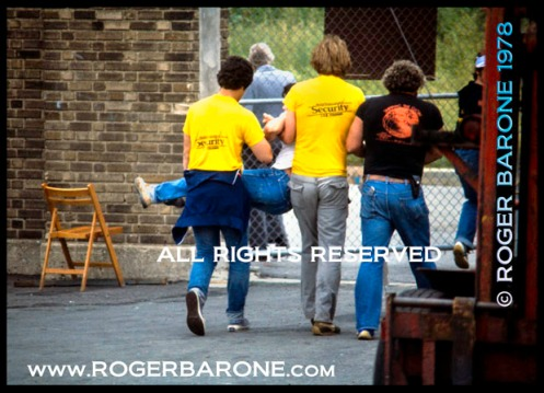 Rowdy fan escorted from JFK Stadium Rolling Stones concert (6/17/1) photo: © roger barone