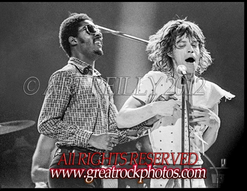"Rolling Stones' singer Mick Jagger and Motown's Stevie Wonder perform ""Uptight and Satisfaction"" together during encor at Philly Spectrum Arena, July 21, 1972. photo © Art Reilly 1972"