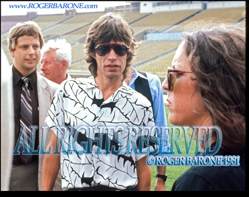Rolling Stones Mick Jagger and Lisa Robinson JFK Stadium , August 26, 1981 © roger barone
