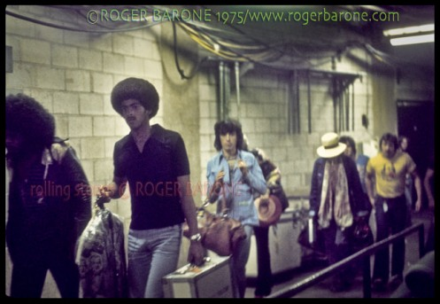 Rolling Stones walking backstage to the dressing romms at Spectrum Arena, June 30, 1975. © roger barone 1975