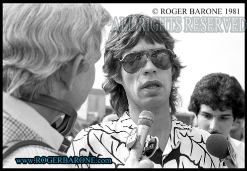 Mick Jagger interviewed at STONES JFK Stadium press conference; © roger barone 1981