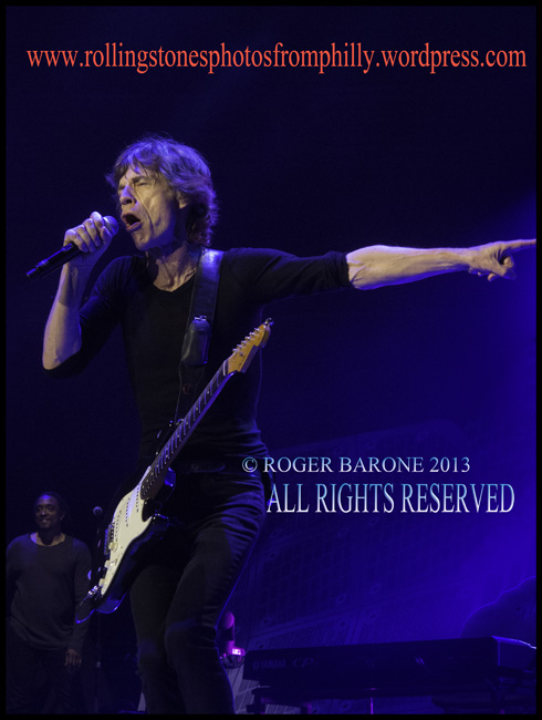 Mick Jagger plays fender stratocaster guitar at Wells Fargo Center Philly. June 21, 2013, © roger barone