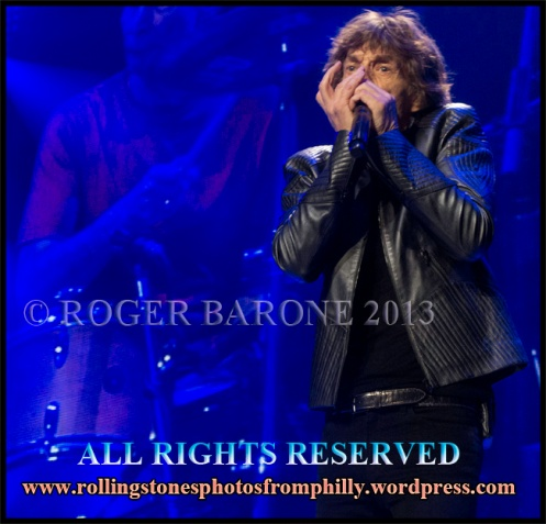 Mick Jagger playing Blues Harp on Midnight Rambler, june 21, 2013, photo by roger barone