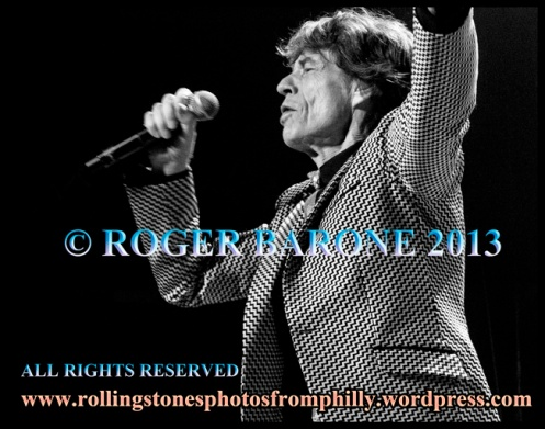 "Mick Jagger sings ""Get Off My CLoud"" opening song. Wells Fargo Center, june 21, 2013, © roger barone"