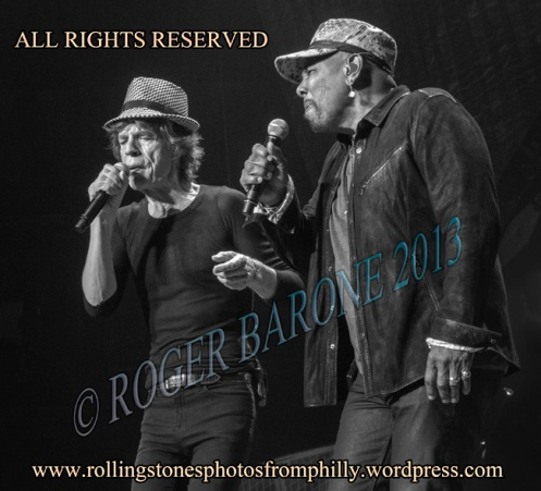 "Mick Jagger and Aaron Neville singing ""Under The Boardwalk"" WELLS FARGO CENTER, june 21, 2013, © Roger Barone"