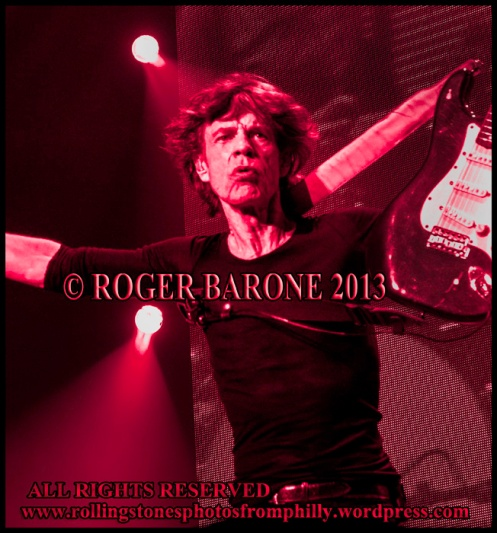 mick jagger with a fender stratacaster accessory around his shoulder, june 21, 2013. Photo roger barone