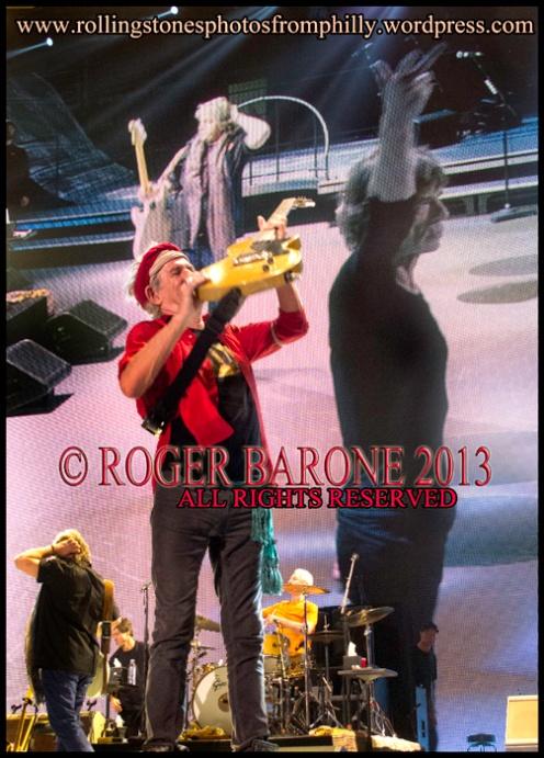 Keith Richards raises  telecaster guitar during encore. June 21, 2013 rolling stones Wells Fargo Center © roger barone