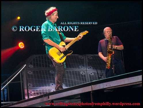 "Saxophone player gets the spotlight during Rolling Stones ""Brown Sugar"" photo by roger barone philly june 21, 2013"