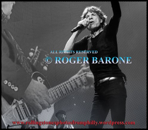 "Mick Jagger gesturing while playing ""Midnight Rambler"" in Philly. June 21, 2013. © roger barone"