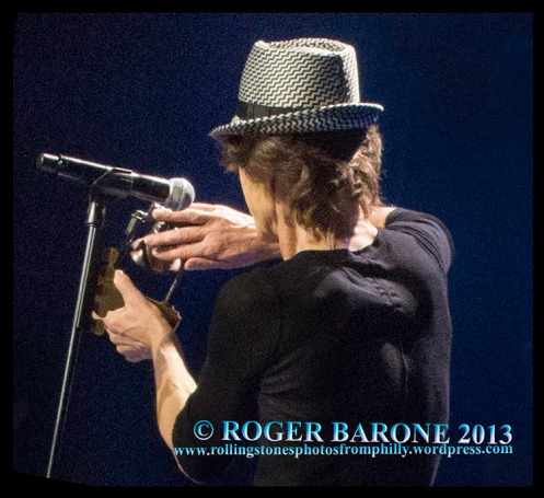 Mick Jagger shows off the mini Liberty Bell he received from the City of Philadelphia in a special moment before one of the Stones' concerts at the Wells Fargo Center. © Roger Barone 2013