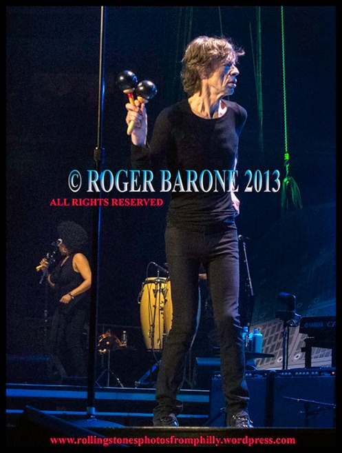 "Mick Jagger playing maracas on ""Can't You Hear Me Knockin"" Wells Fargo Center, June 21, 2013, photo by roger barone"