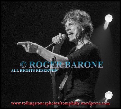 "Mick Jagger with black Fender Stratocaster guitar in Philadephia ""Miss You"" © Roger Barone 2013"