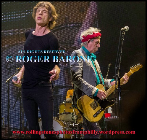 "Mick Jagger and Keith Richards singing ""One More Shot"" at Wells Fargo Center, June 21, 2013, photo by roger barone"