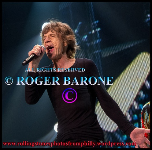 "Mick Jagger singing ""Satisfaction"" at the Wells Fargo Center, june 21, 2013, photo by roger barone"