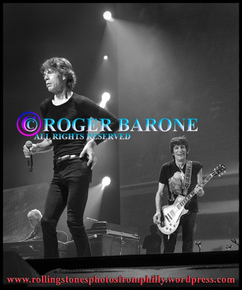 "Mick Jagger Ronnie Wood playing ""Midnight Rambler"" at Wells Fargo Center Philly. photo by roger barone"