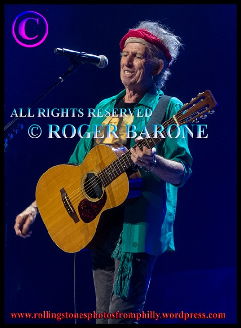 Keith Richards playing acoustic guitar at Wells Fargo Center, june 21, 2013. photo by roger barone