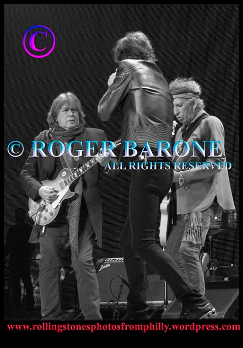 "Mick Taylor, Mick Jagger and Keith Richards playing ""Midnight Rambler"" in philly. june 21, 2013 © Roger Barone"