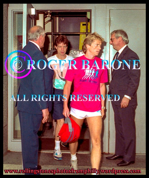 Rolling Stones Mick Jagger and trainer, Torje Eike, exit Four Seasons Hotel in Philly photo by roger barone 1989