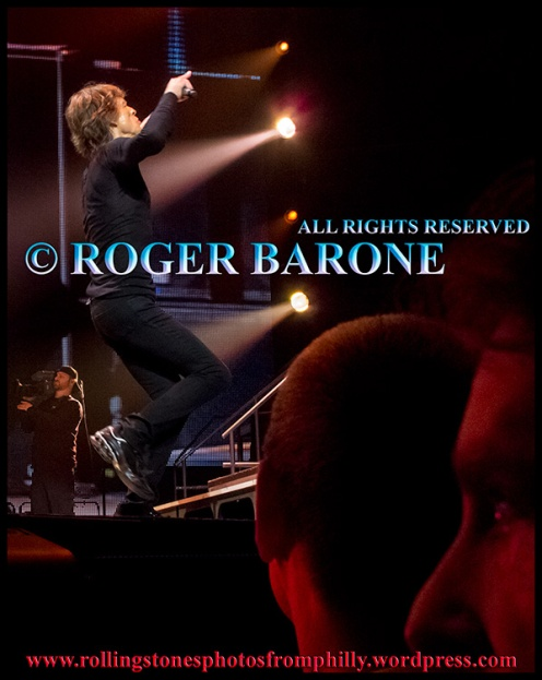 """Mick Jagger performs """"Brown Jagger"""" as fans look on. Wells Fargo Center, june 21, 2013. © Roger Barone"""