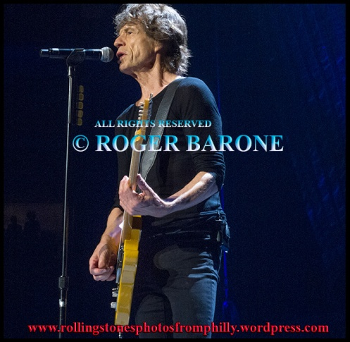 "Mick Jagger playing guitar ""Doom and Gloom"" Wells Fargo Center Philly. photo by roger barone"