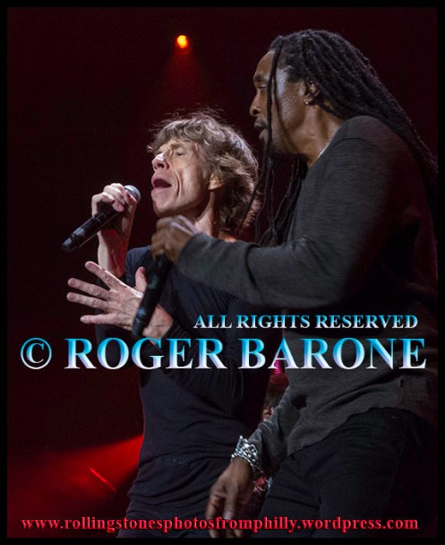 "mick jagger and bernard fowler singing ""Sympathy for the Devil"" Wells Fargo Center, june 21, 2013, photo: roger barone"