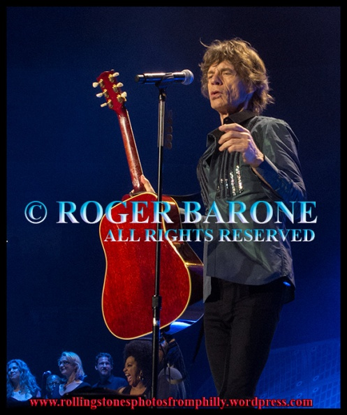 "Mick Jagger playing ""You Can't Always Get What You Want"" with Gibson Hummingbird acoustic guitar. Wells Fargo Center 2013. photo by roger barone"