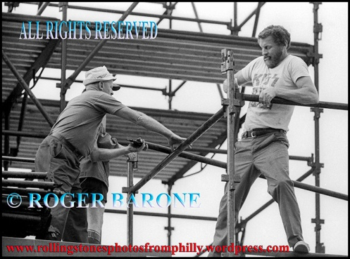 "Mo and ""Chappy"" O'Shea setting up scaffolding for the Rolling Stones at JFK Stadium, june 12, 1978. photo by roger barone"