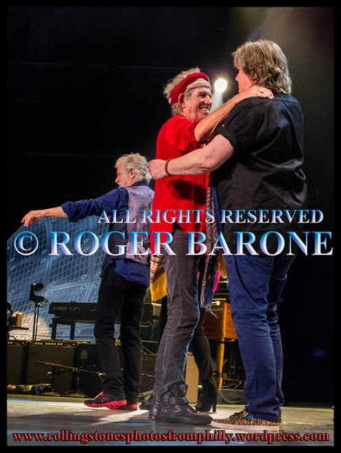 Keith Richards and Mick Taylor hugging after Rolling Stones show in Philly. June 21, 2013. photo by roger barone
