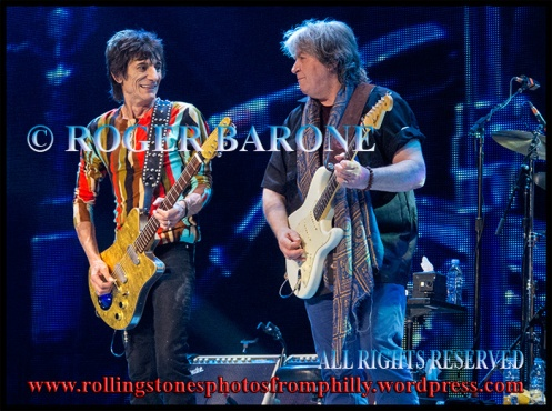 "Rolling Stones' guitarists, Ronnie Wood, left, and Mick Taylor, performing ""Satisfaction"" at the Wells Fargo Center, june 21, 2013© Roger Barone 2013"