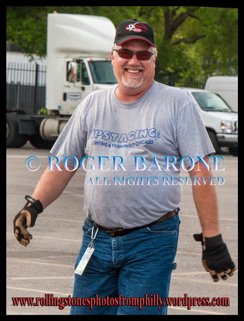 Rolling Stones' truck driver, Randy Bates, walks through Wells Fargo parking lot. june 18, 2013. photo by roger barone