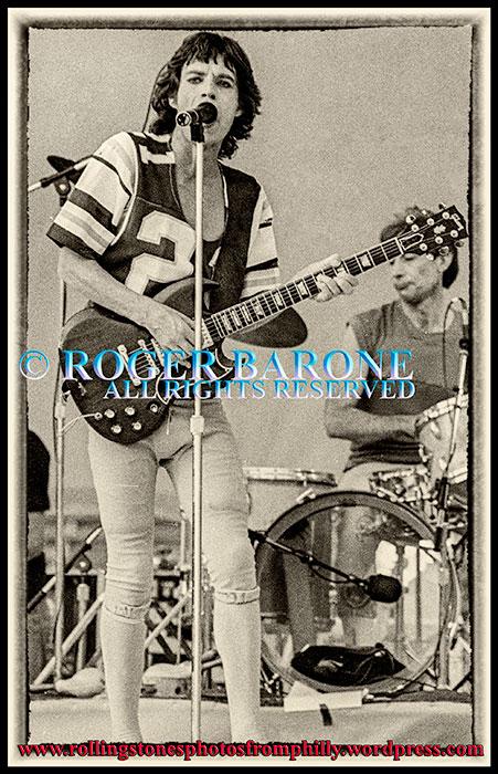 Mick Jagger wearing Eagles football jersey, plays gibson sg guitar at JFK Stadium, september 26, 1981