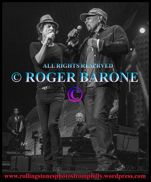 "Mick Jagger and Aaron Neville singing ""Under the Boardwalk"" Philly, june 21, 2013. photo by roger barone"